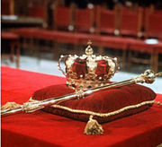 A crown and sceptre, the symbol of the power of a king, from Wikipedia